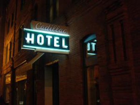 cadillac hotel sign lit up