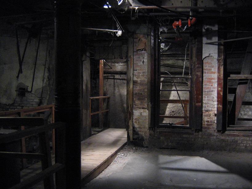 Dark brick lined hallways of the Seattle Underground